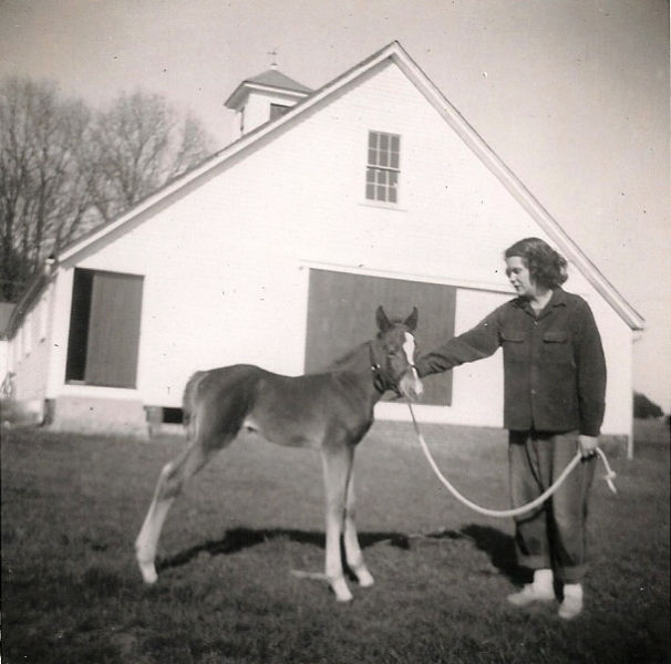 Barbara-Cole-with-the-first-foal-she-raised-Doctor-Faustus-Lippitt-Victory-x-Katie-Twilight-foaled-April-21-1955