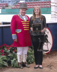 Abbey Lockhart receives the 2014 Outstanding Youth Award from Ringmaster, Billy Whitley