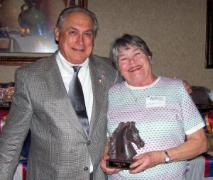 President Pete Jaeger presents Carol Lee (R) with the 2008 Jack Benny Award.